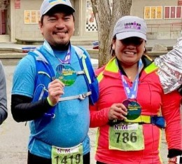 Happy Couple finishes the Napa Marathon and poses with medals