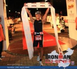 Steve crosses the finish line at Ironman China triathlon