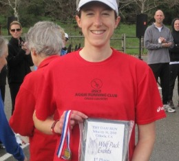 Samo poses with her award plaque for finishing 1st at local duathlon