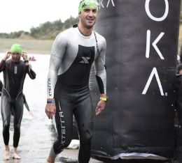 Man finishes the swim portion of a triathlon