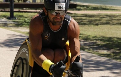 Athlete competes in a racing wheelchair.