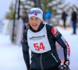 Woman on XC ski portion of winter triathlon.
