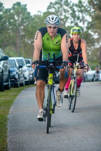 Man and woman on bicycle in aquabike race