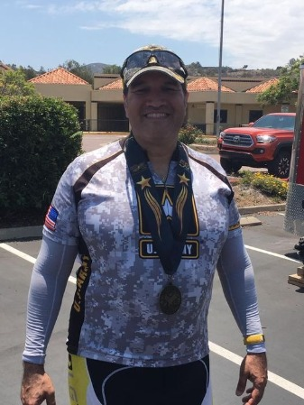 Man smiles with medal earned around his neck