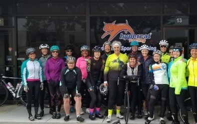 Women on Wheels Group in front of Hypercat