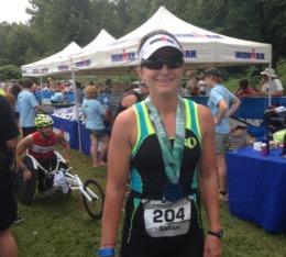 Woman finisher at triathlon