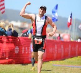 Sean triumphantly finishes the Escape from Alcatraz triathlon
