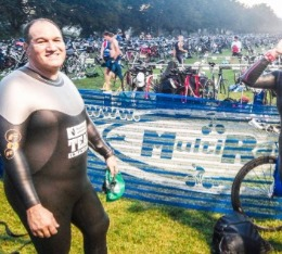 Male athletes in wetsuit poses in transition before Aquathlon Nationals.