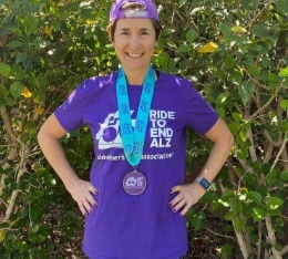Hypercat athlete Julie poses with her finisher medal and t-shirt.